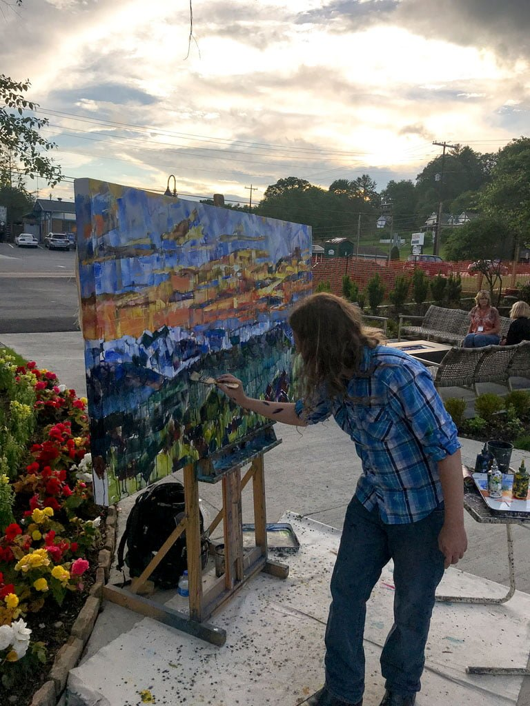 Live painting in Banner Elk during a beautiful sunset.  Artist Kent Paulette is working on a Mountain Landscape painting outside at Sorrento's Italian Bistro.